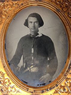 CONFEDERATE SOLDIER AMBROTYPE, wearing homespun sweater/battle shirt with gilded buttons. Wears a Colt pistol along with a Sheffield style knife tucked under a Pre-War Eagle plate. 1/6pl. Ambro Collection John M.Mike Hunt.