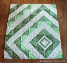 I don't like asymmetrical quilts that much, but the colors are lovely.