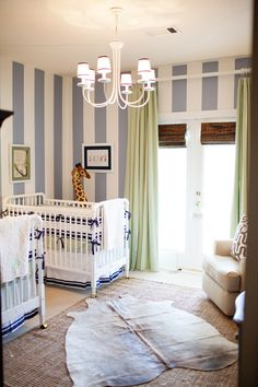 Twin Boy Striped Gray Nursery--vertical stripes; neutral colors; block color wall art w/storybook photos; navy blue bureau with gold details.