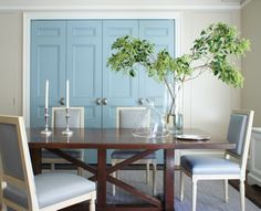 Clean lines and just the right amount of color used in an unexpected place (the double doors) make for an elegant dining room.