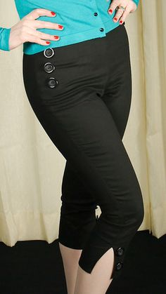 Hilda Black Button Capri Pants:Here's a classic staple of every gals wardrobe! These are black stretch twill sailor style capris. They have large decorative buttons at hips and at the knee slits. Side zipper entry. 98percent cotton and 2percent elastine. Machine wash cold and hang dry. Size Waist Hips XS 24in 34in SM 26in 36in MED 28in 38in LG 30in 40in XL 32in 42in... $40.00