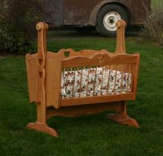 Wyatt's cradle; the finished product.  I make these for individuals out of a variety of wood.  They are actual rocking cradles, have a locking pin to hold steady. $600.  Shipping is your option.  You can pick them up here in Oregon or have them shipped.  The bedding can be purchased separately.