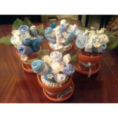 Onesie flower pots for centerpieces. Baby shower