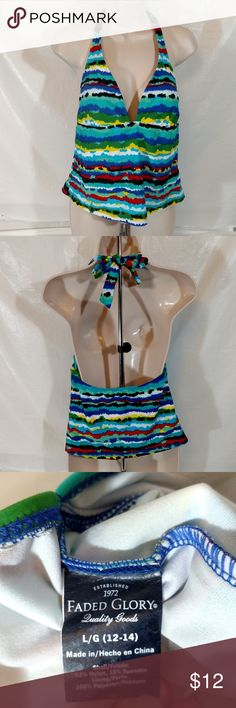 FADED GLORY Halter Tankini Swim Top Women Size L ITEM DESCRIPTION: Faded Glory Halter Style Tankini Top with Padding   Women Size L(12-14)  Multi-Color: Shades of Blue Green Black White Yellow Red  Closure: Pullover and Ties behind the neck  Fabric: 82% Nylon 18% Spandex  Made in China  ITEM CONDITION:  GREAT USED CONDITION! ITEM MEASUREMENTS (Laying flat): Chest (Armpit to Armpit): 14.5 in Back Length: 9 in Waist(at smallest point): 15 in Faded Glory Swim Bikinis