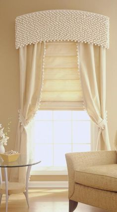 I love this idea of using ball fringe to cover a cornice. Many possibilities with different colors!
