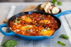 Ever made shakshuka? Traditionally a North African/Israeli breakfast dish, this budget-friendly meal is gaining popularity fast. Get our recipe here. Israeli Breakfast, Savory Breakfast, Breakfast Dishes, How To Make Shakshuka, Shakshuka Recipes, Food N, Nutritious Meals, Chorizo, Brunch Recipes