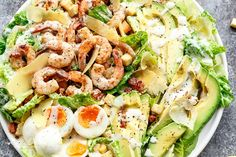 Grilled and Skinny Lemon Garlic Shrimp Caesar Salad with a lightened up creamy Caesar dressing is a complete meal in a salad and a family favourite! | http://cafedelites.com Shrimp Ceasar Salad, Caesar Salad, Seafood Salad, Pasta Salad, Carb Less Meals, Lemon Garlic Shrimp, Marinated Shrimp, Best Salad Recipes, Chicken Spaghetti