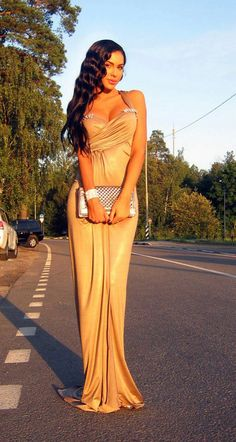 Russian Fashionista Olesya Malinskaya  standing on a random street in a FAB gown. Okay.