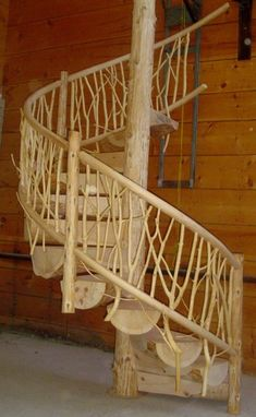 Now this is what a spiral stairway in a log home should look like!