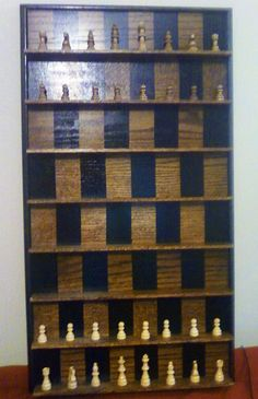 How to Make a Vertical Wall-Mounted Chessboard. I've always wanted one, but could not justify the hefty 200+ dollar price tag. Just found great diy instructions.