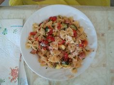 Butterfly with Zucchini, tomatoes and bacon. Parmigiano cheese and prezzemolo