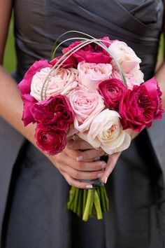 combination of hot pink english garden roses, hot pint ranunculus and light pink rose varieties - without the grass
