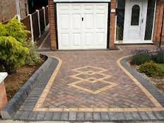 Imagination and vision created this beautiful driveway. you can Create this by using Pacific Interlocks Holland Pavers in Charcoal, B11 (Sahara Sand - Cream/ tan) and B9 (island Ember - Red/charcoal)