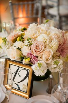 Pale pink and white centerpieces at this Montecito wedding designed by Brooke Keegan - photos by LA-based Callaway Gable Photography via JunebugWeddings.com