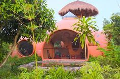 In Thailand, A Cozy Dome-Shaped Abode That Costs US$8,000 To Build.  As the laws are lax in the country, Areen was able to build this 500-square-foot home in six weeks.   This idea was conceived when Areen was visiting his friend, Hajjar Gibran—the latter let Areen build a home on his mango plantation, giving him advice on the project and letting his son-in-law, Tao, help out.