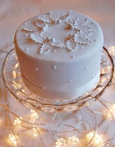 One of our Christmas cake designs. Rich brandy-fed fruit cake covered in marzipan and sugarpaste icing - - Christmas Cake Designs, Christmas Cake Decorations, Holiday Cakes, Christmas Goodies, Christmas Desserts, Christmas Treats, Christmas Cakes, Fondant Christmas Cake, Xmas Cakes