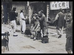 China, 1905 Peripatetic barber with customer, probably in Shanghai