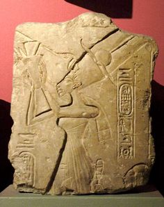 Damaged relief found at Amarna depicting Queen Nefertiti giving offerings in the crown of Amun.