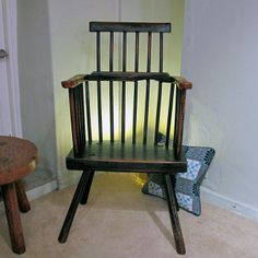 A George III Welsh Comb Back Chair with extensive green/black paint