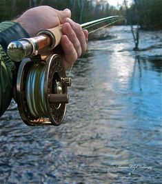Is that a normal fishing rod? Looks super shiny. Is that a wooden handle? That can't be an ordinary fishing rod.