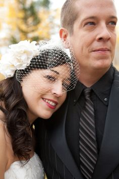 38-bridal-couple-close-up-woman-smiling-man-looking-away-birdcage-veil-red-lipstick-striped-tie