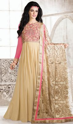 Infuse a new twist to the latest trend with this beige and pink embroidered georgette gown. The ethnic floral patch, lace, resham and stones work on the dress adds a sign of attractiveness statement for your look. #MagnificentPrincessStyleGown