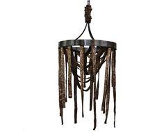 """MMUTARE Particolarissimo lampadario, si ispira agli oggetti ornamentali utilizzati durante le feste popolari. Di notevoli dimensioni, soprattutto in altezza, l'opera è costituita da un cerchio portante realizzato in ferro trattato a cera nera, sul quale vengono """"appesi"""" diversi nastri di tessuto irrigiditi ed infine trattato con una innovativa tecnica di metallizzazione e poi patinato a cera.   Dimensioni: Ø76 cm x H105 cm"""
