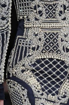 The detail of silver and gold threads with head sewn pearls and beads is beyond incredible.