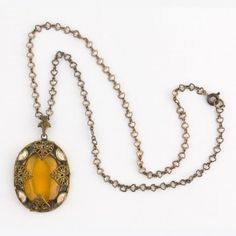 Antique Edwardian brass, enamel and amber glass pendant on brass chain. Bohemia Czechoslovakia. pdbg108(e)