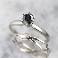Recycled 14k White Gold Engagement Ring with black/gray speckled Diamond.