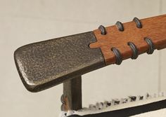 Detail on the Vérité President Chair arm. #Bronze, leather and #Palmwood.