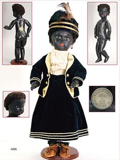 """DANEL & CIE French Bebe, dark-skinned, black squirted porcelain, fix inset brown Paperweight eyes, closed mouth, mark in the neck 8, black French jointed body, body marking in the back """"Jouets et jeux Paris magasin des enfants"""", dress was sewed of old fabric, c. 1892, 48 cm, unusual, rare, black old frizz wig"""
