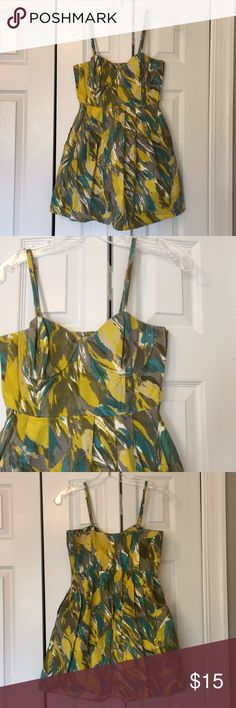 Blue, gray and yellow bustier flounce dress Super flattering! Brand and fabric content tag cut out. 31 inches long. 15 inches from armpit to armpit. Dresses