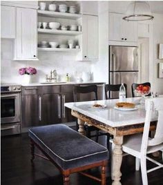 Chic Kitchen-Dining Space Weathered furniture keeps this cottage from looking too formal. This weekend home's open-concept space pairs a vintage farmhouse-style dining table with a contemporary kitchen. Stainless-steel cabinets and dark-stained pin Eat In Kitchen, Kitchen Dining, Kitchen Decor, Eclectic Kitchen, Kitchen Industrial, Kitchen Ideas, Kitchen White, Kitchen Interior, Kitchen Seating