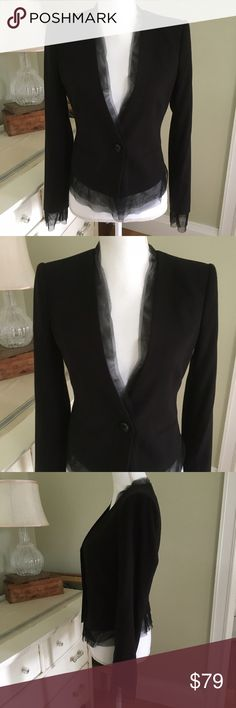 """BCBGMAXAZARIA Black Blazer with Black Netting This gorgeous asymmetrical black blazer from BCBGMAXAZARIA features black netting along the neckline, hem and cuffs for added sophistication. Also features long sleeves, one button closure and two front faux pockets. Size: XS. Chest: 16.5"""". Waist: 14.5"""". Length (back): 17"""" at jacket; 19"""" at netting. Length (front): 22.5"""" at jacket; 25"""" at netting. BCBGMaxAzria Jackets & Coats Blazers"""