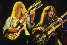 Duelling double guitars. Alex Lifeson and Geddy Lee of Rush.