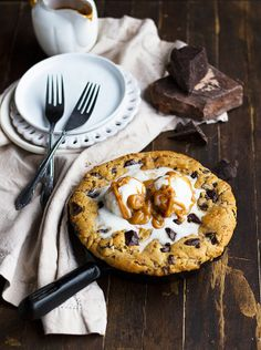 All the ingredients for a perfect cookie are here! This Peanut Butter Chocolate Chunk Skillet Cookie has it all plus a layer of chocolate peanut butter in the middle to make it heaven!