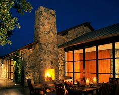 Like the use of the outer chimney as an outdoor fireplace