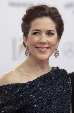 Dazzling: The mother-of-four looked beautiful in a pair of diamond chandelier earrings ...