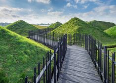 Studio Marco Vermeulen adds grass blanket over rooftop pyramids of Dutch island museum.