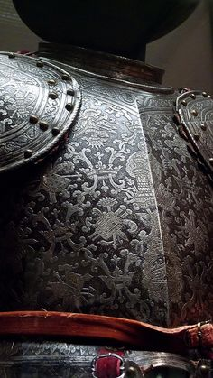 Closeup of breastplate of Half Armor for use on foot in the field by Milan Italy armorer Master of the Castle Mark 1600 CE etched partially russeted and gilded steel (2), via Flickr.