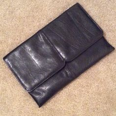 Large genuine leather clutch/evening handbag Black genuine leather clutch/evening handbag. Excellent condition. 11 1/4 X 7 1/2 inches. Smoke free home. No trades No brand Bags Clutches & Wristlets