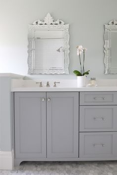 Cabinet paint color is Benjamin Moore Coventry Gray. Stunning bathroom design || Studio McGee
