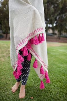 Cozy up in this handmade tassel blanket.