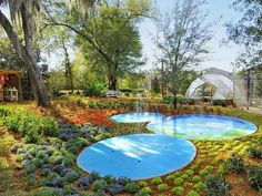 Inspired by Epcot  At the other end of the Mickey Mouse-shaped splash pad is a science and nature station and an Epcot-inspired greenhouse.