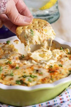 Ready in minutes and the perfect party starter, this Hot Artichoke Asiago Dip recipe is a win with every guest! | http://TheSuburbanSoapbox.com