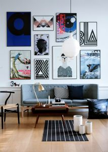 love the super-sized art wall - looks great as it is proportionally too big for the sofa - creates an incredibly tantalising effect.