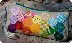 I love cute little pouches and purses and I especially love when people take totally random fabric and put it together in a rainbow. From TinyApartmentCrafts on Flickr.