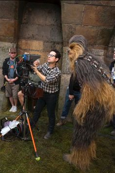 'Star Wars: the Force Awakens': 15 Behind-the-Scenes Photos Fans Saw at the 'Celebration' Panel | J.J. Abrams with Chewbacca (Peter Mayhew) | EW.com