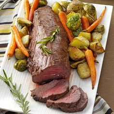 Beef Tenderloin with Roasted Vegetables Recipe -I appreciate this recipe because it includes a side dish of roasted potatoes, brussels sprouts and carrots, giving me one less dish to think about!                                              —Janet Tucker, Bellevue, Ohio